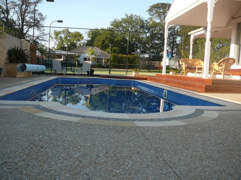 Exposed aggregate cement for around the pool, veranda and ...