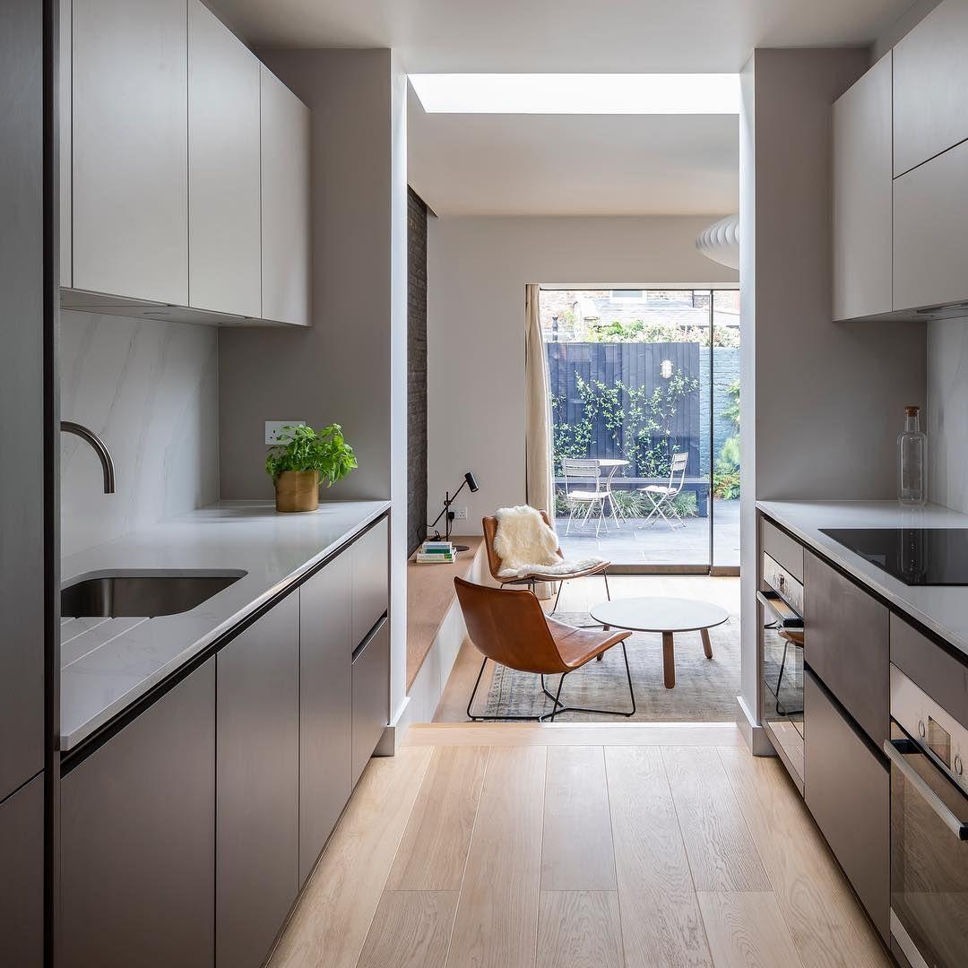 narrow galley kitchen with matt black units in 2020