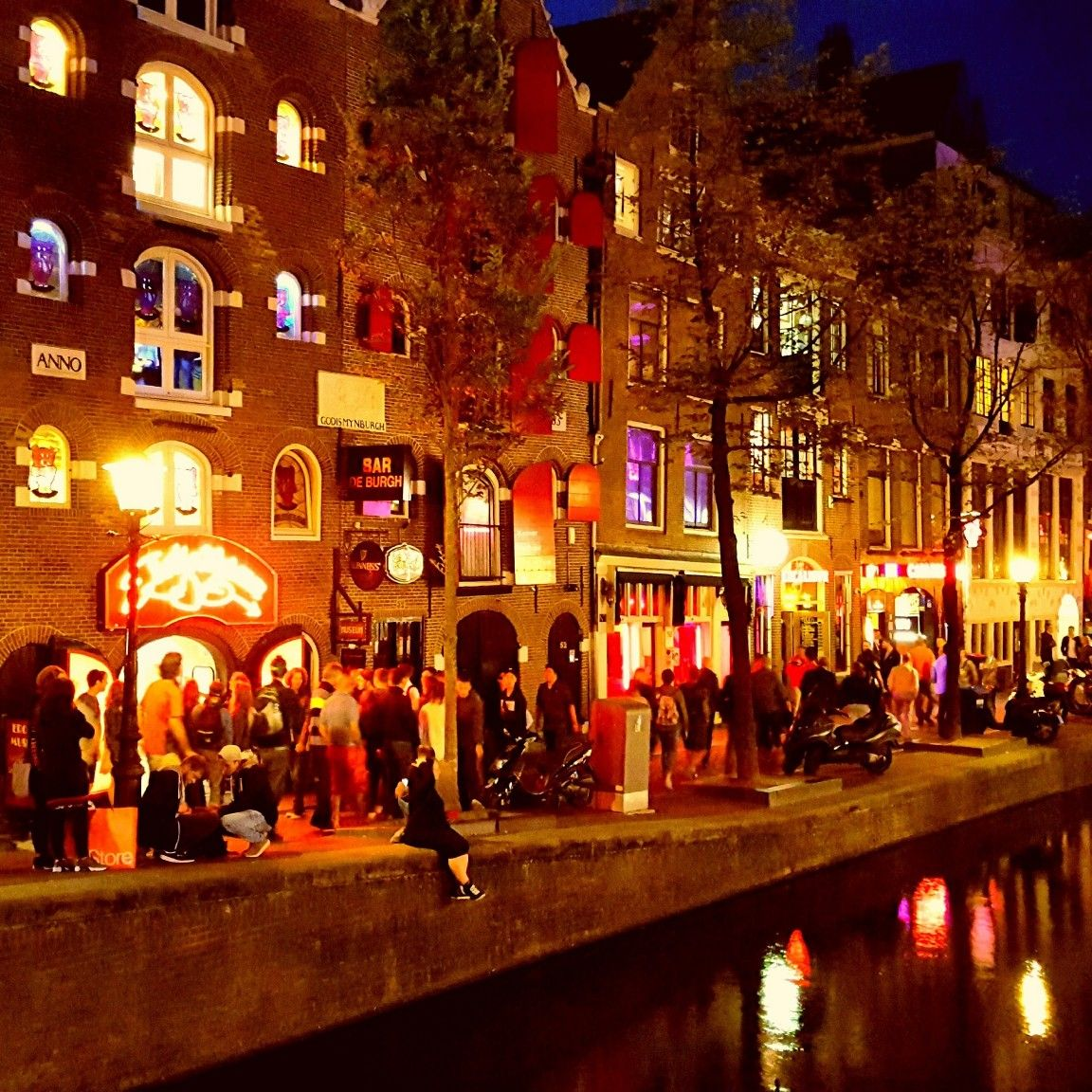 The Main Canal Of The Red Light District Of Amsterdam The
