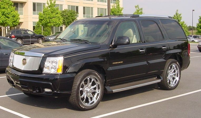 """Another one of my previous Escalades.  Check out the 'gold emblems, 21"""" wheels and tires with custom grill. All I needed was a 'Rap Group' and a 'Posse'"""