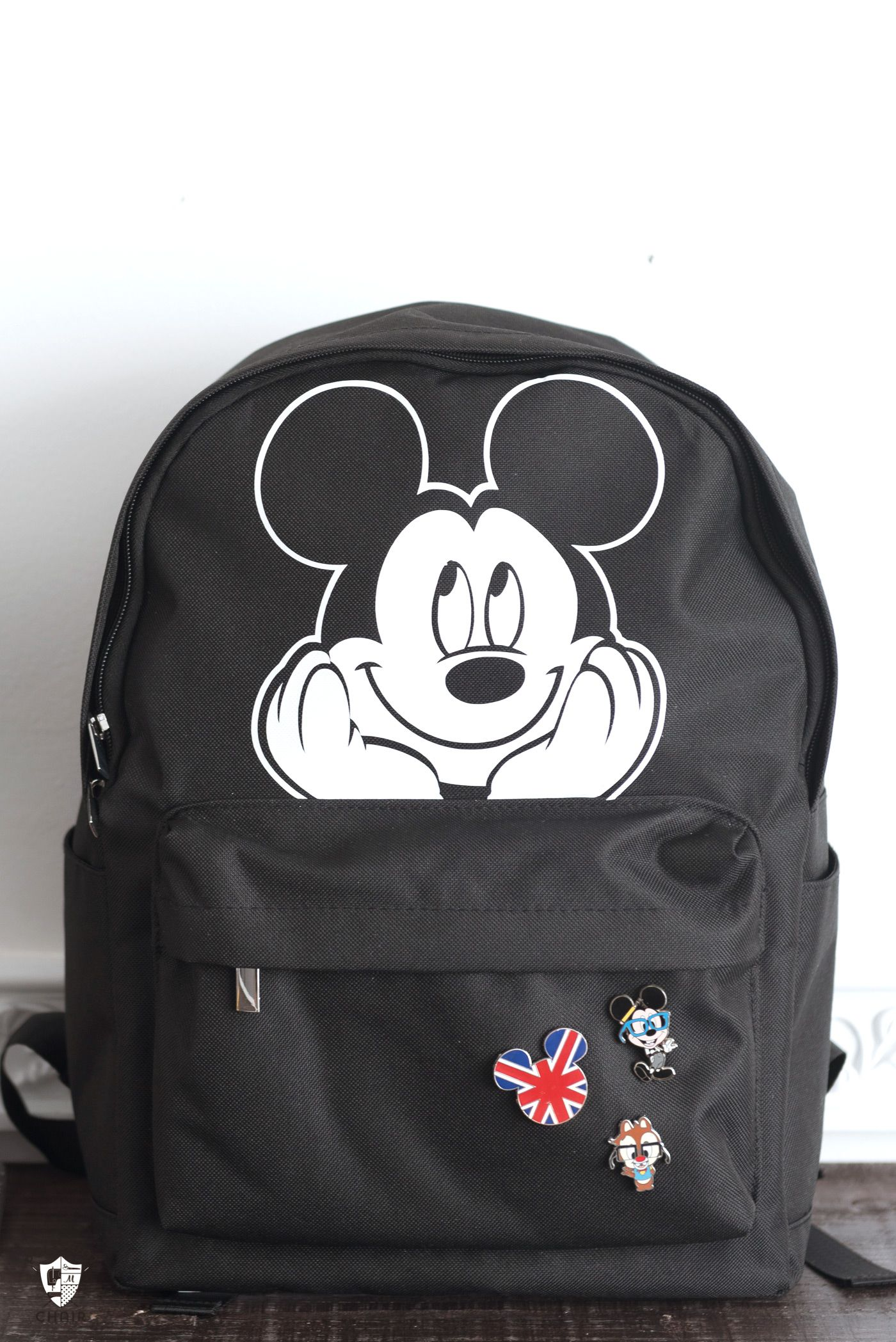 2ab1872b8c2 Create a custom backpack with a bit of iron-on vinyl and the Cricut  EasyPress. Learn how to make a fun Disney Mickey Mouse backpack.
