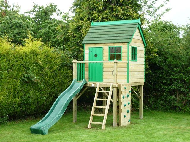 Raised playhouse with slide and climbing wall | Backyard Playhouse ...