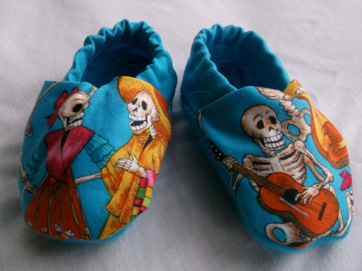 Baby Booties in Blue Day of the Dead Fabric by DesignedForDelilah on Etsy https://www.etsy.com/listing/116601947/baby-booties-in-blue-day-of-the-dead