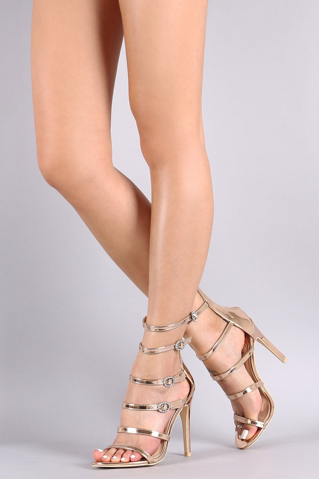 68aedeec174 This dress heel features a multiple laddered straps with adjustable buckles  accent