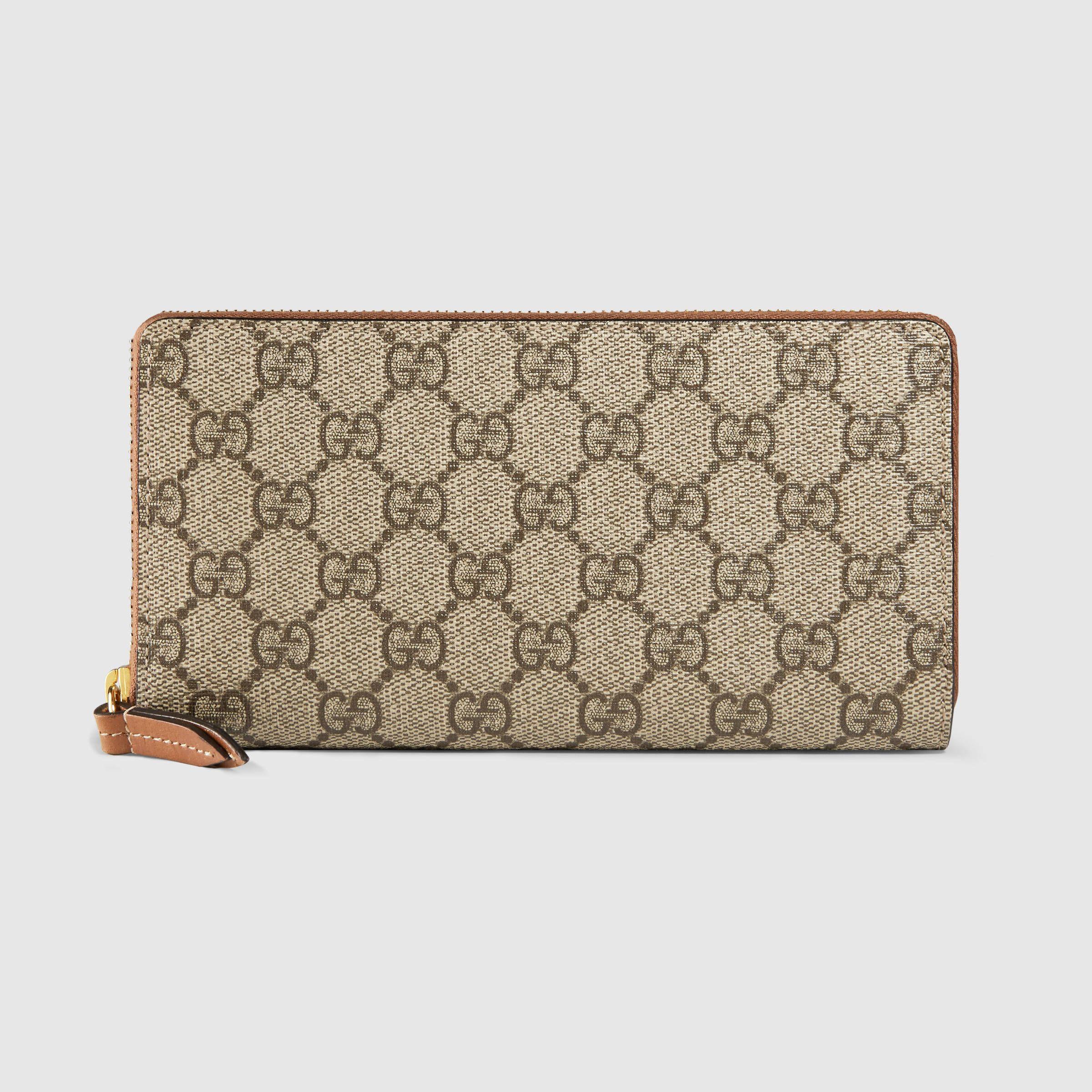 f464beb29b9 Gucci Women - GG Supreme zip around wallet