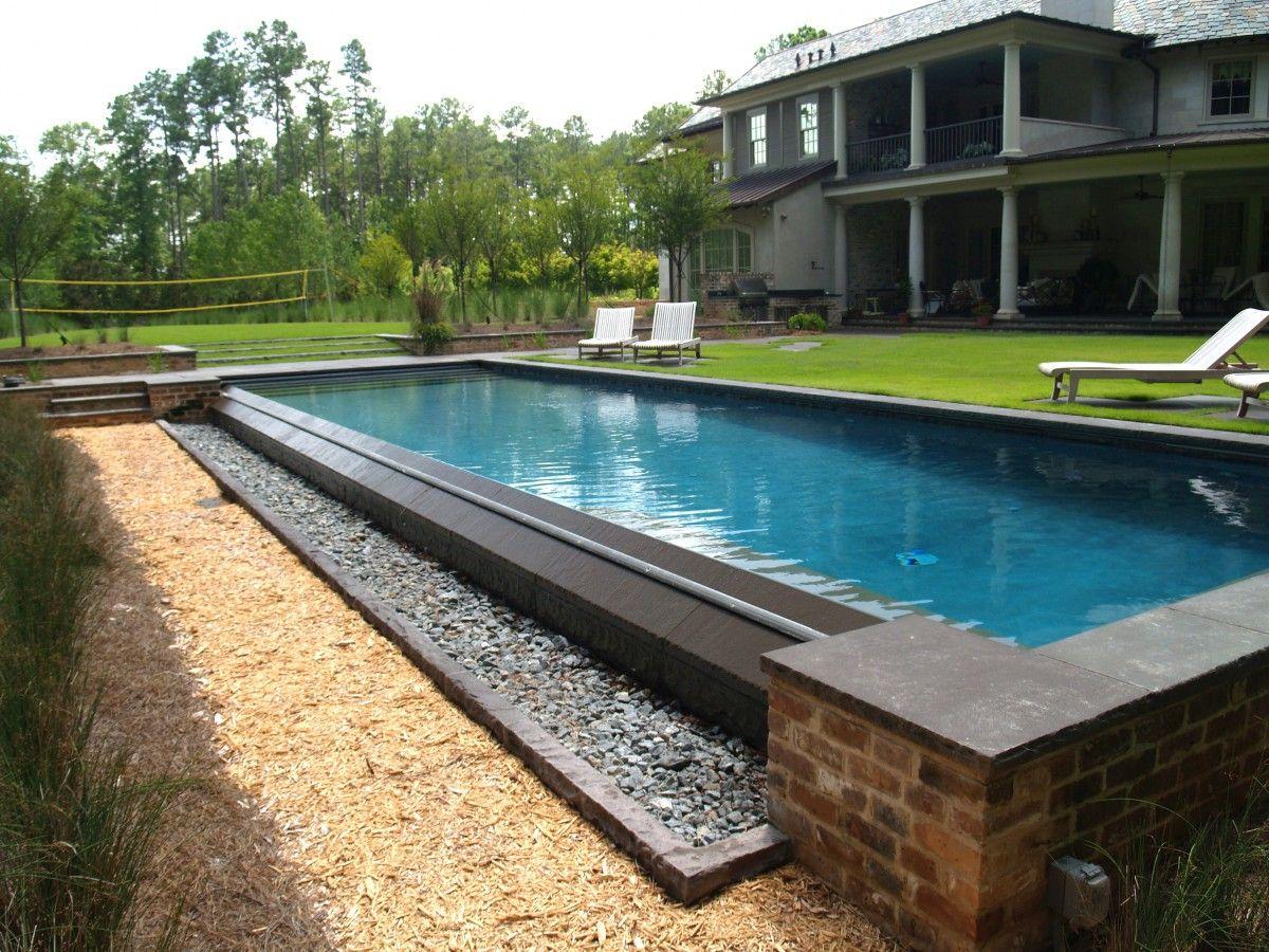 0024 ewing aquatech pools infinity edge linear perimeter for Garden pond overflow design