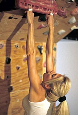Hangboard training for rock climbing. Here, hanging by four ...