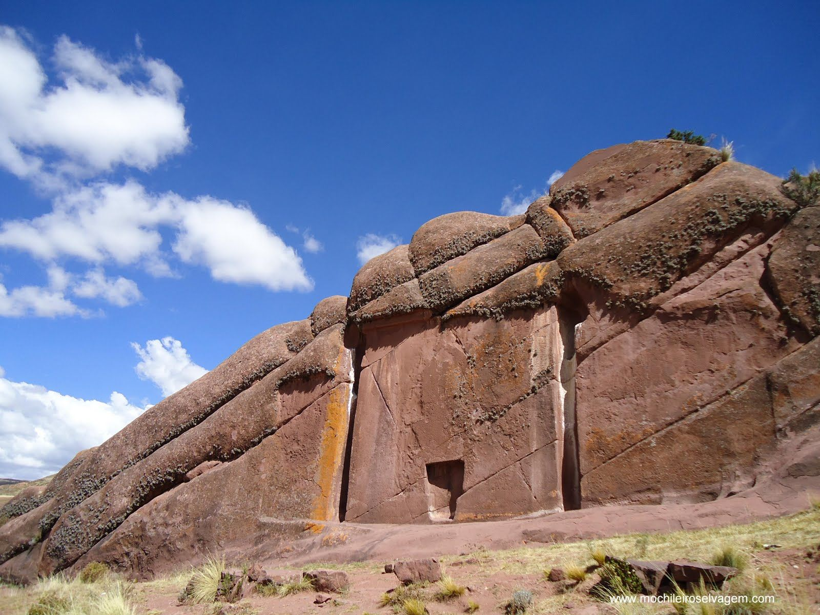 Puerta de Hayu Marca or Gate of the Gods, Lake Titicaca, Perú - carved out of the natural rock face, it measures exactly 23 feet in height and width, with a smaller alcove in the center at the base which measures in at just under 6 feet in height.