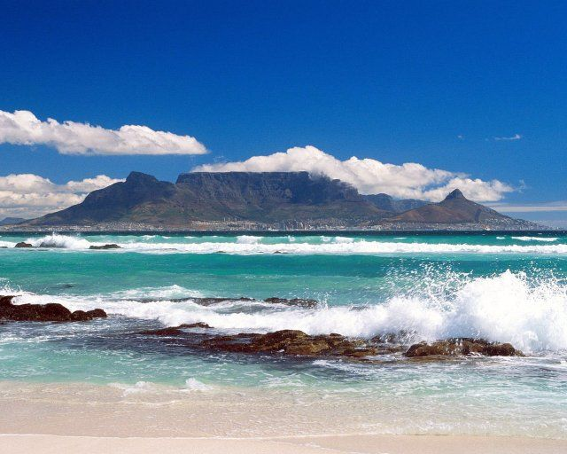 Table Mountain in Cape Town, South Africa.     I did not take this picture but I did get the chance to visit Table Mountain in September 2011 and it was fabulous. I would recommend a visit to Cape Town to anyone!