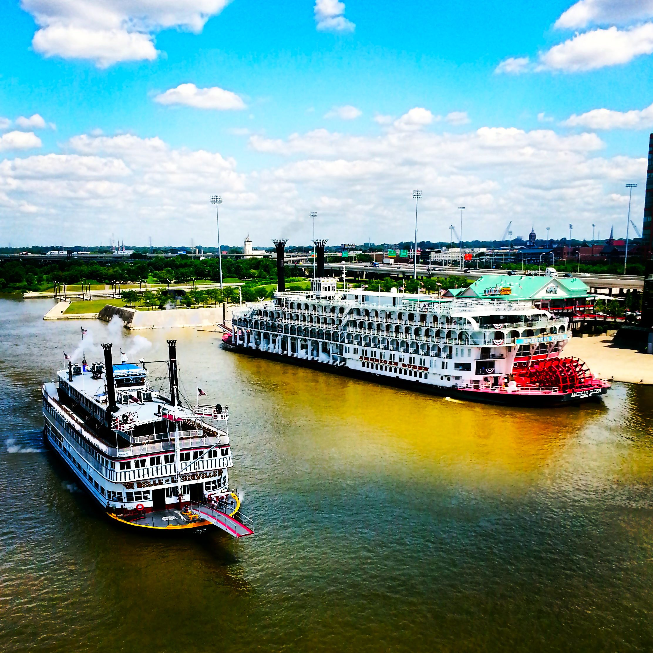 The Belle Of Louisville Cruising Passed The American Queen