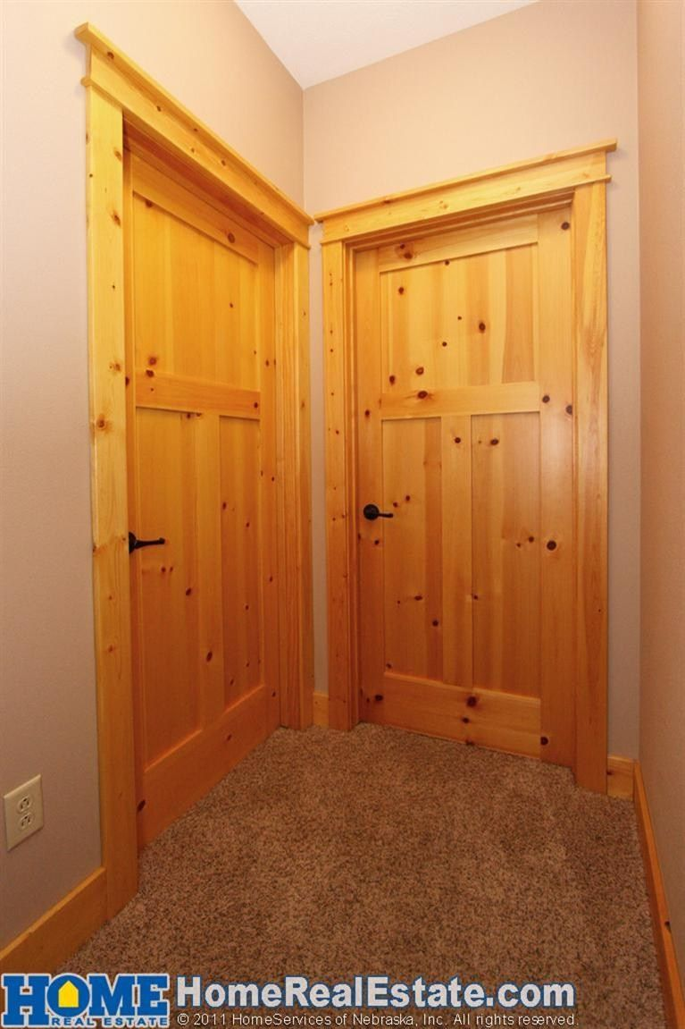Check out the natural knotty pine trim and solid wood doors ...