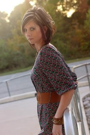 Popular green and cranberry belted print dress, and accessorized with our Lenny and Eva Line.  Call to order 423-545-9786.
