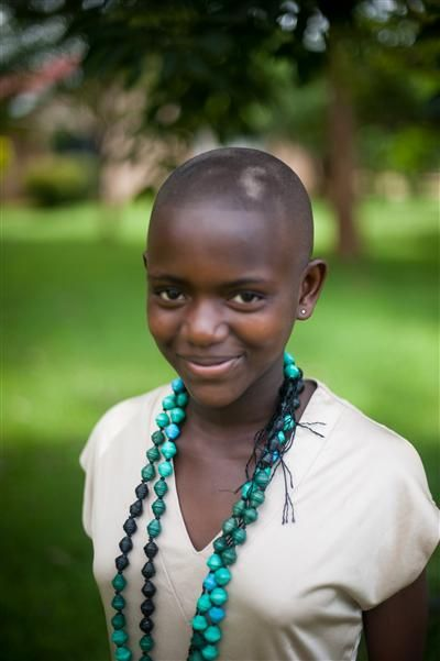 One of our Artisans in Uganda wearing the paper bead necklace. This beauty is one of the many reasons Iove noonday collection.