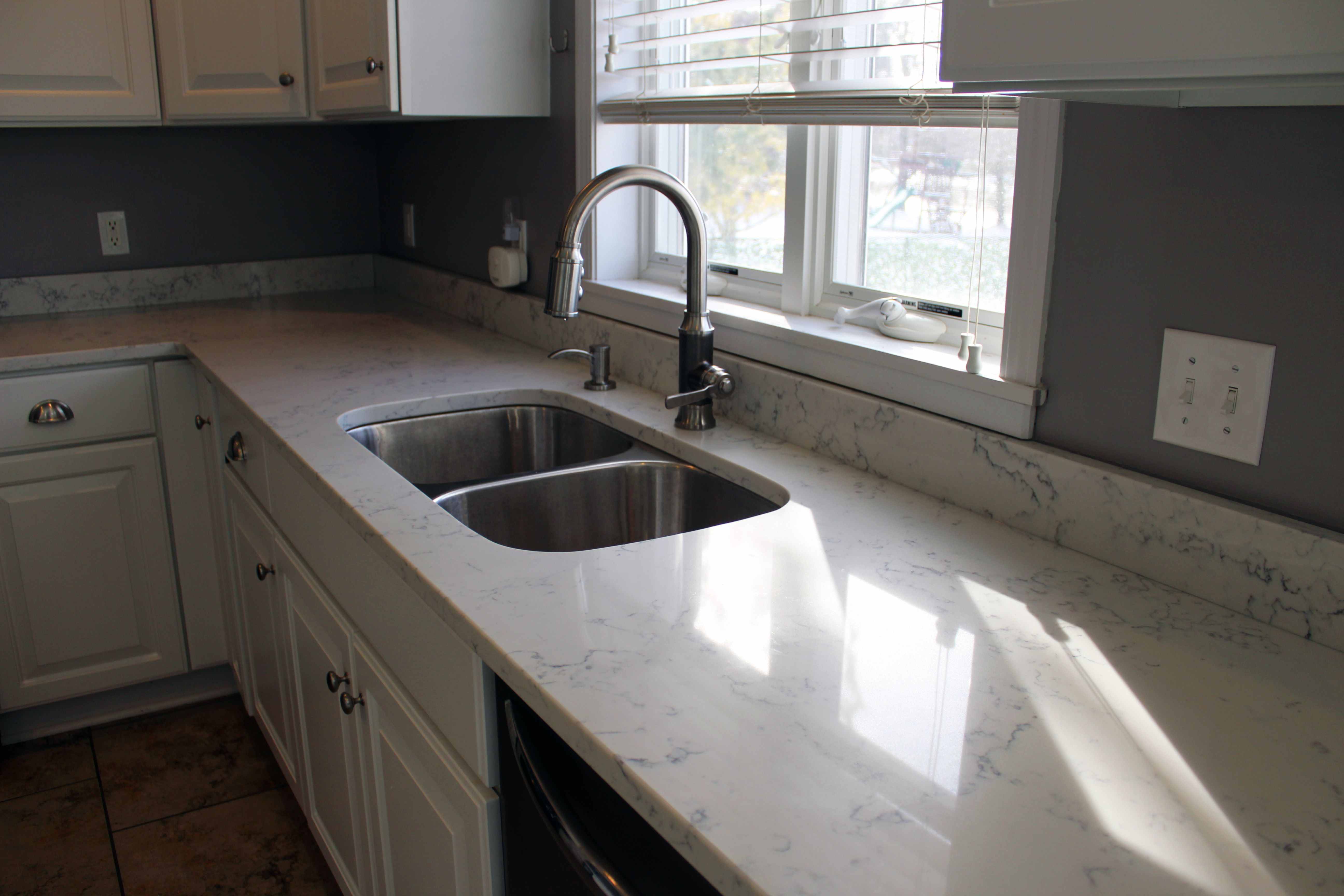 Delightful Carrara White Quartz By Aggranite; 502A Sink By Midwest/Aggranite.