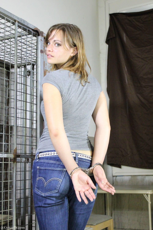 handcuffs behind little woman