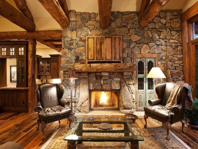 "Психолог онлайн. ""Психология личного пространства"" http://psychologieshomo.ru Craftsman Living Room with Exposed beam, Verona Hillstone, stone fireplace, Glass panel door, Custom TV Cover"