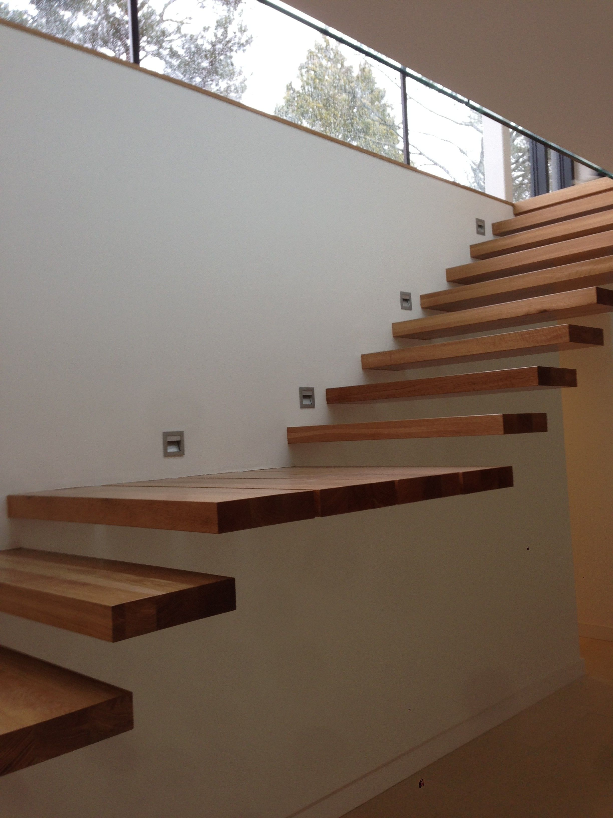 Amazing teak wood floating stairs attach on wall without Floating stairs