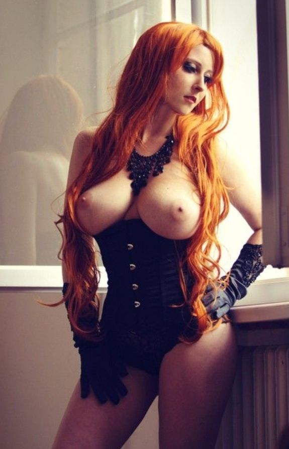 ROBERTA: Sexy redhead in corsets topless