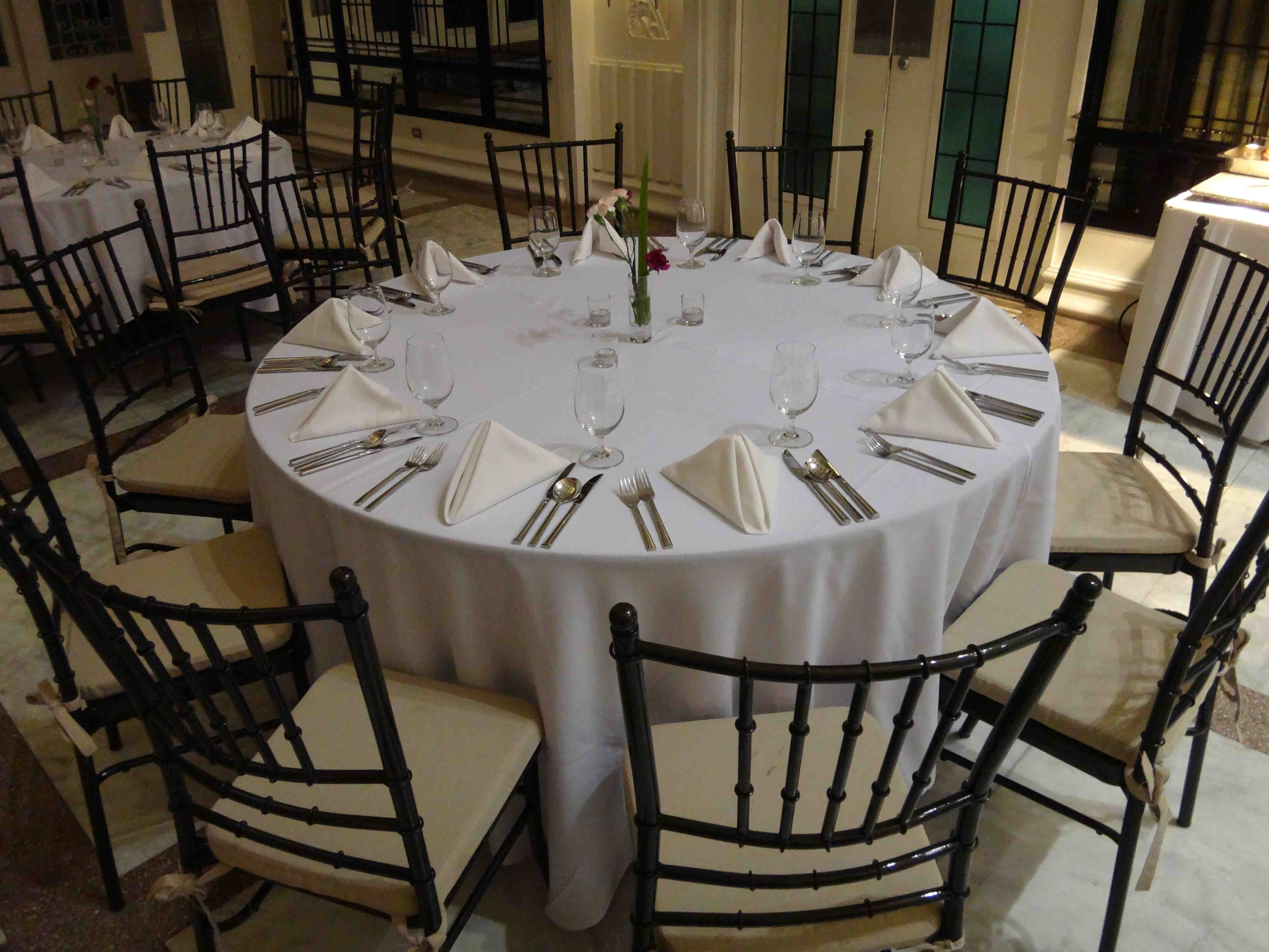 Enderun Basic Setup rounded tables black tiffany chairs
