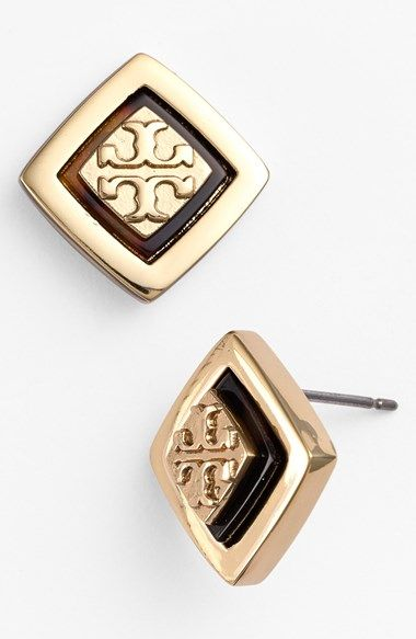 Tory Burch applies her love of tortoiseshell and logo relief-work to shiny stud earrings.