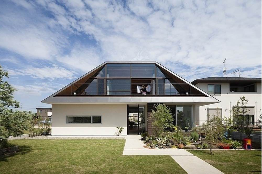 Hip Roof On A Contemporary Home With White Stucco Siding