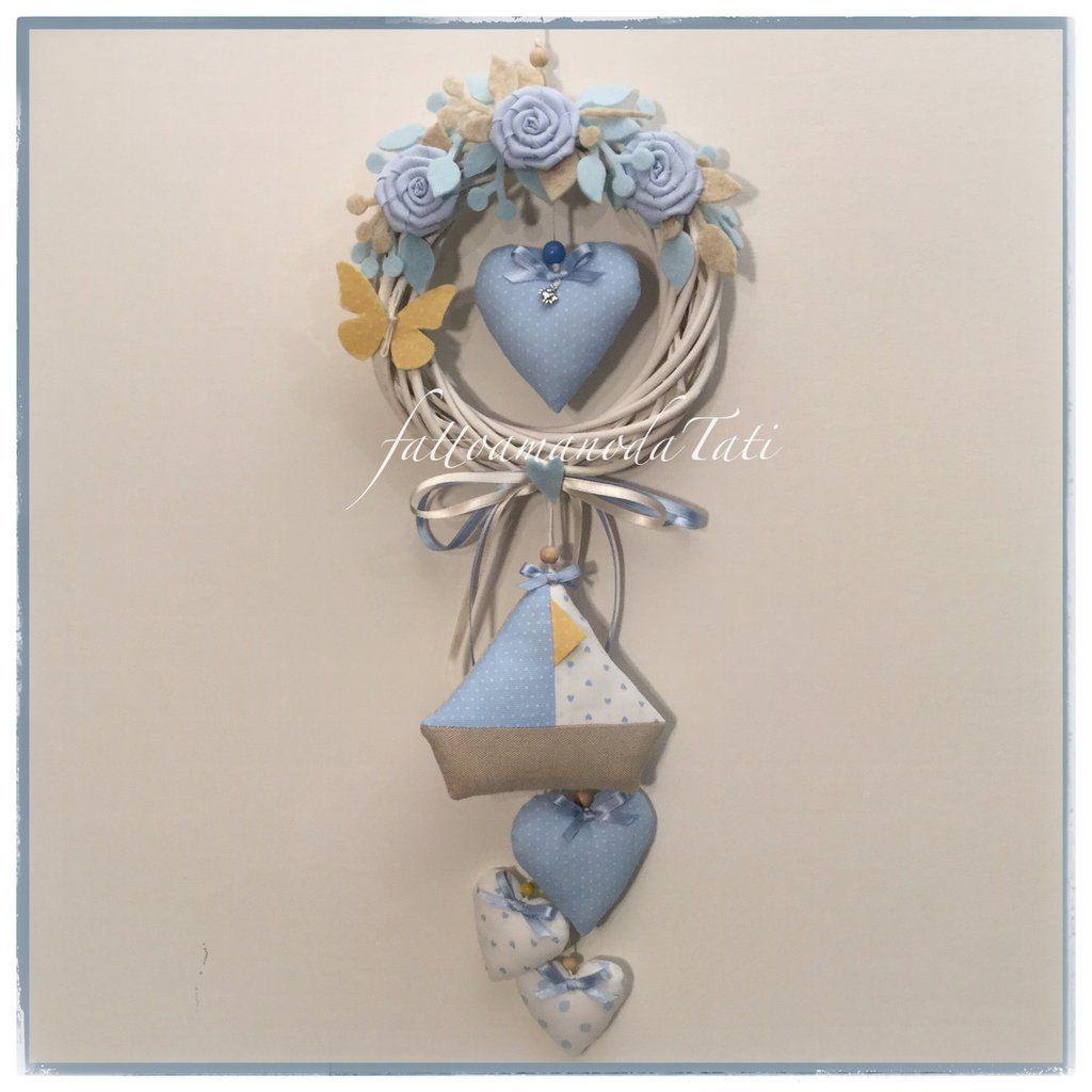 Photo of Wicker birth bow with roses, hearts, sailboat in shades of blue / white and yellow butterfly