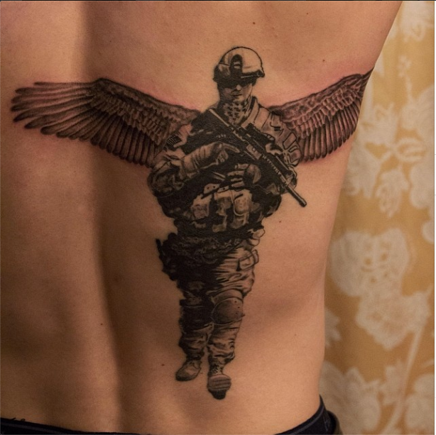 Back Piece Memorial Of A Fallen Soldier R I P In Stylized Realism Done By Angel Antonio Morillas In 2014 Chica Soldier Tattoo Army Tattoos Military Tattoos