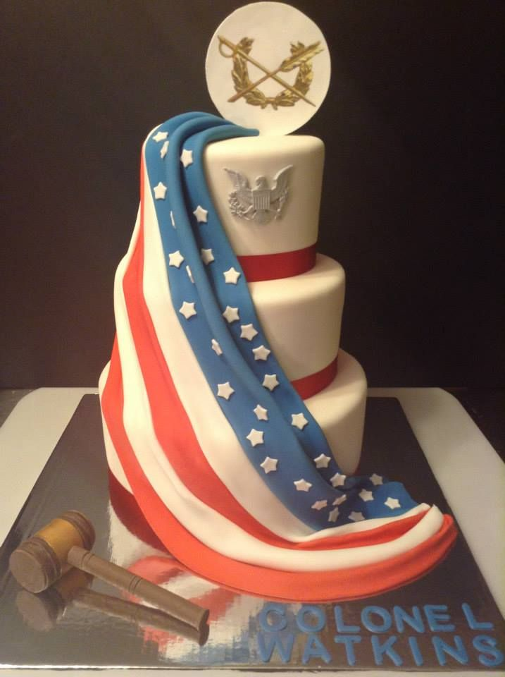 Three tier fondant cake draped in the American flag JAG Crest cake