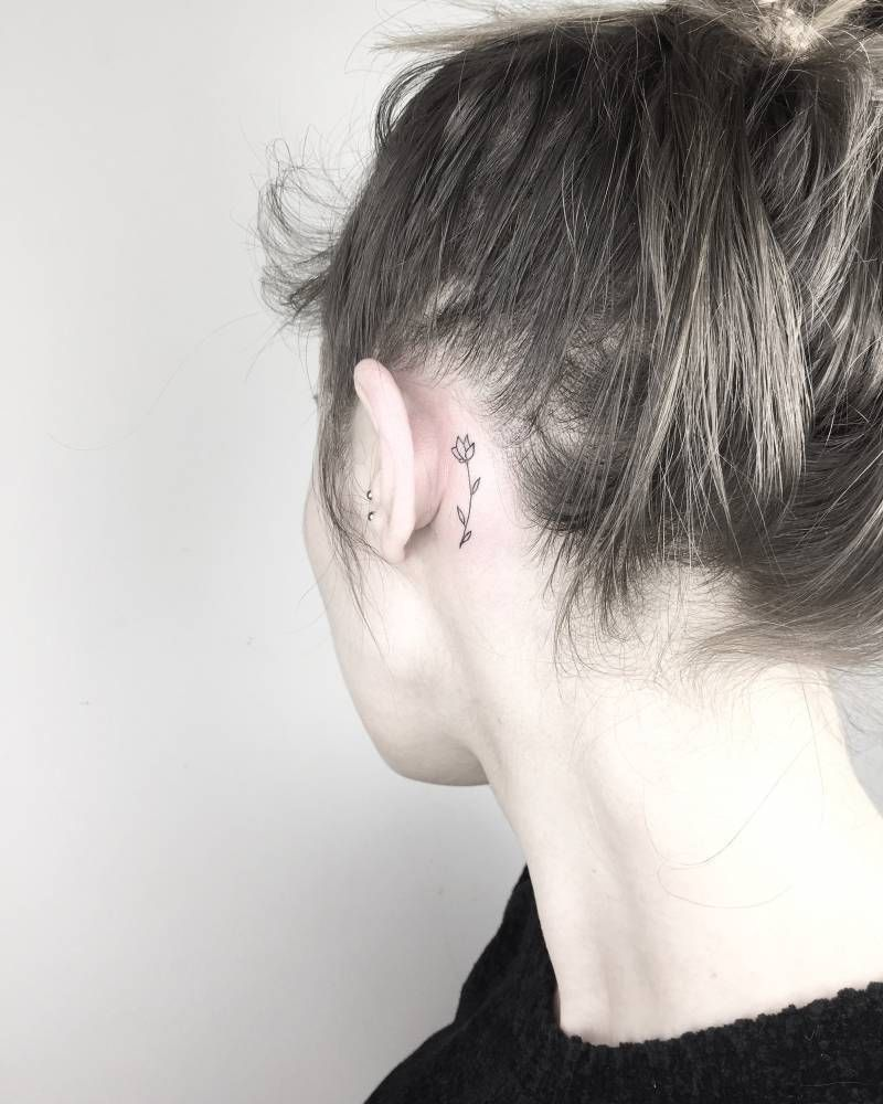 Tiny Black Tulip Tattoo Behind The Left Ear Behind Ear Tattoos Flower Tattoo Ear Tulip Tattoo