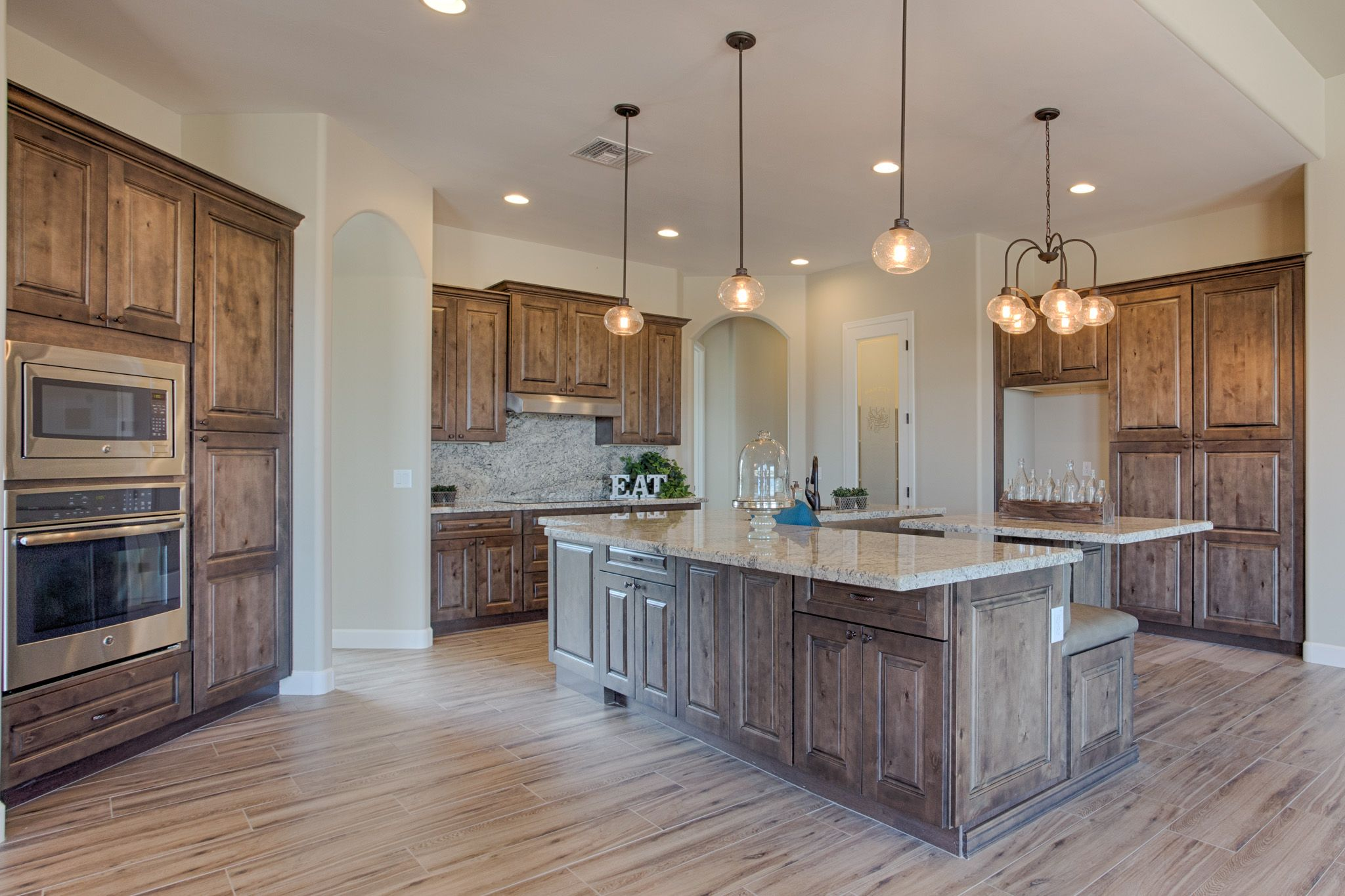 Welcome Guests Into Your Kitchen With Inviting Tahoe Ash Cabinets From Our Value Series Custom Kitchen Cabinets Ash Kitchen Cabinets Modern Farmhouse Kitchens