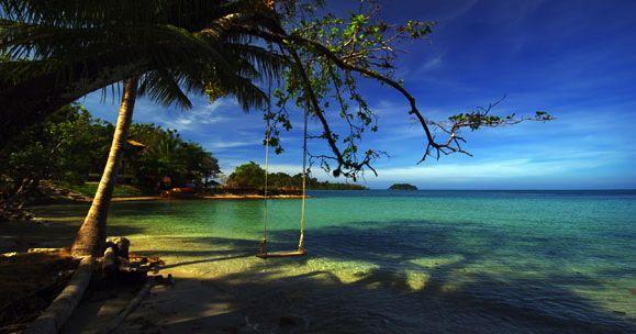 Beach, Deep Blue Sea and a swing  - by Dmitry kushch