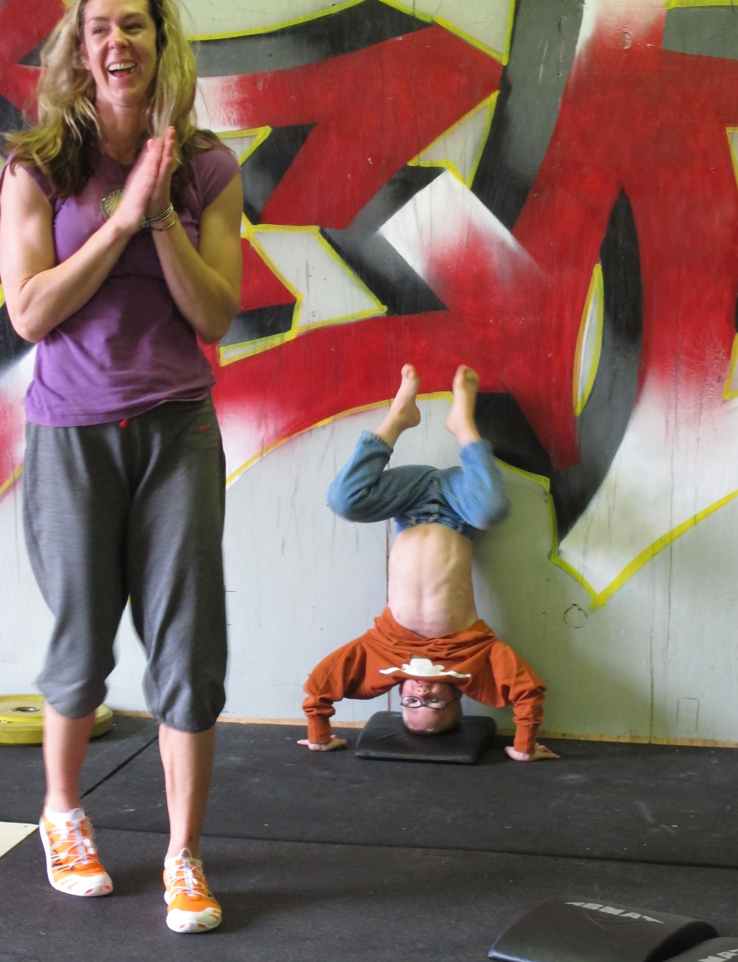 Young Mom cheers her son's handstand pushups