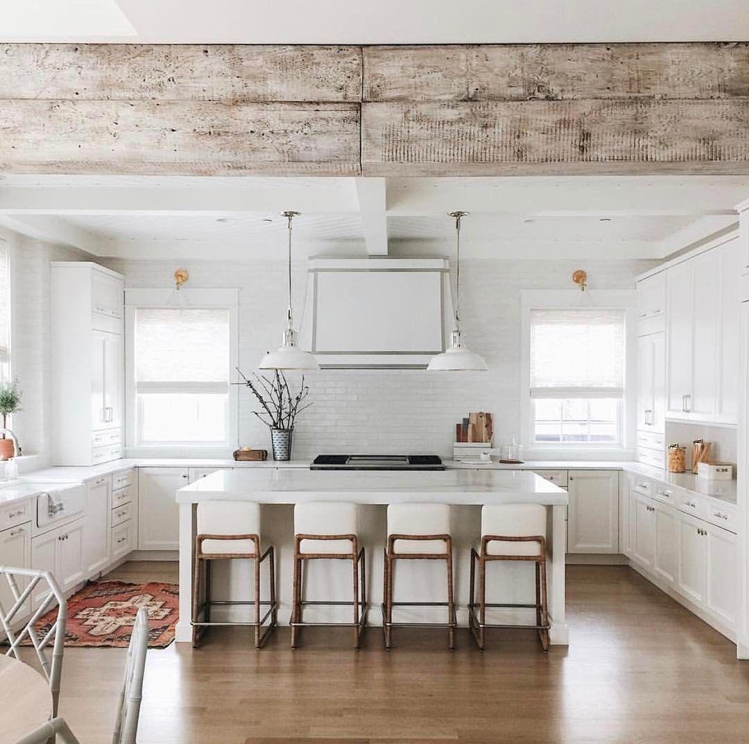 Rustic beam in white modern farmhouse kitchen Barn beams