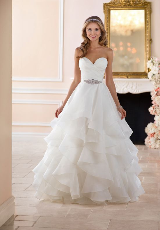 70b5e39bb47 This dramatic layered skirt wedding dress from Stella York is truly a sight  to behold. This classic ball gown made of Royal organza has a voluminous  skirt ...