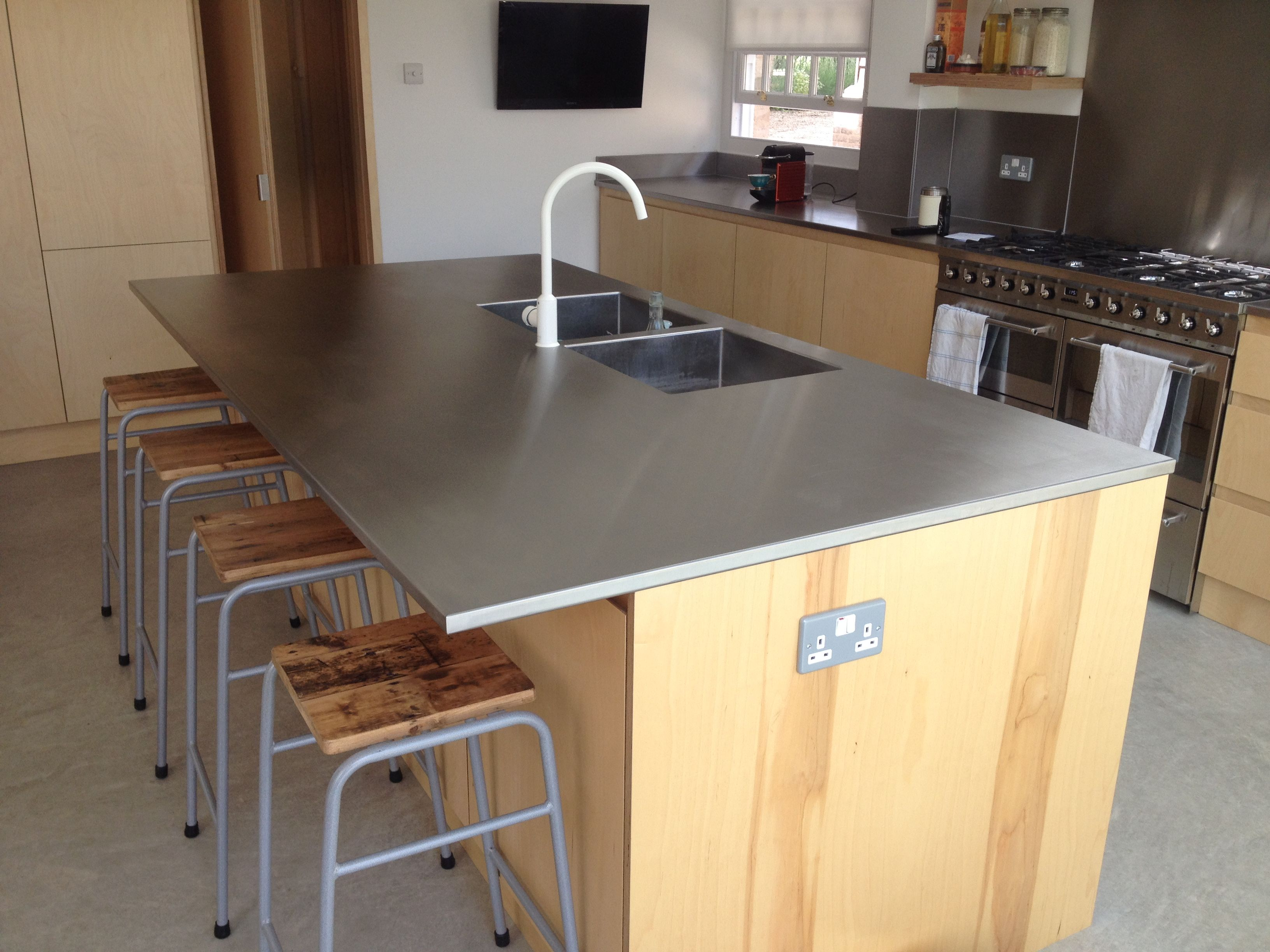 Great Looking Kitchens a great looking stainless steel island worktop here, with