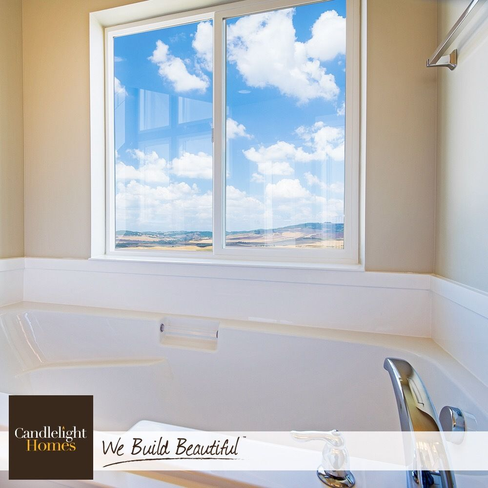 Sit back, relax, and enjoy the view from this relaxing master bath ...