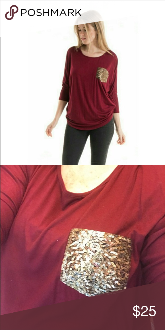 d934d73a410 Wine top with sequin pocket Pretty twist on wine top. Sequin pocket dresses  up this top. Easy wear in a great color. Fashionomics Tops Tees - Long  Sleeve