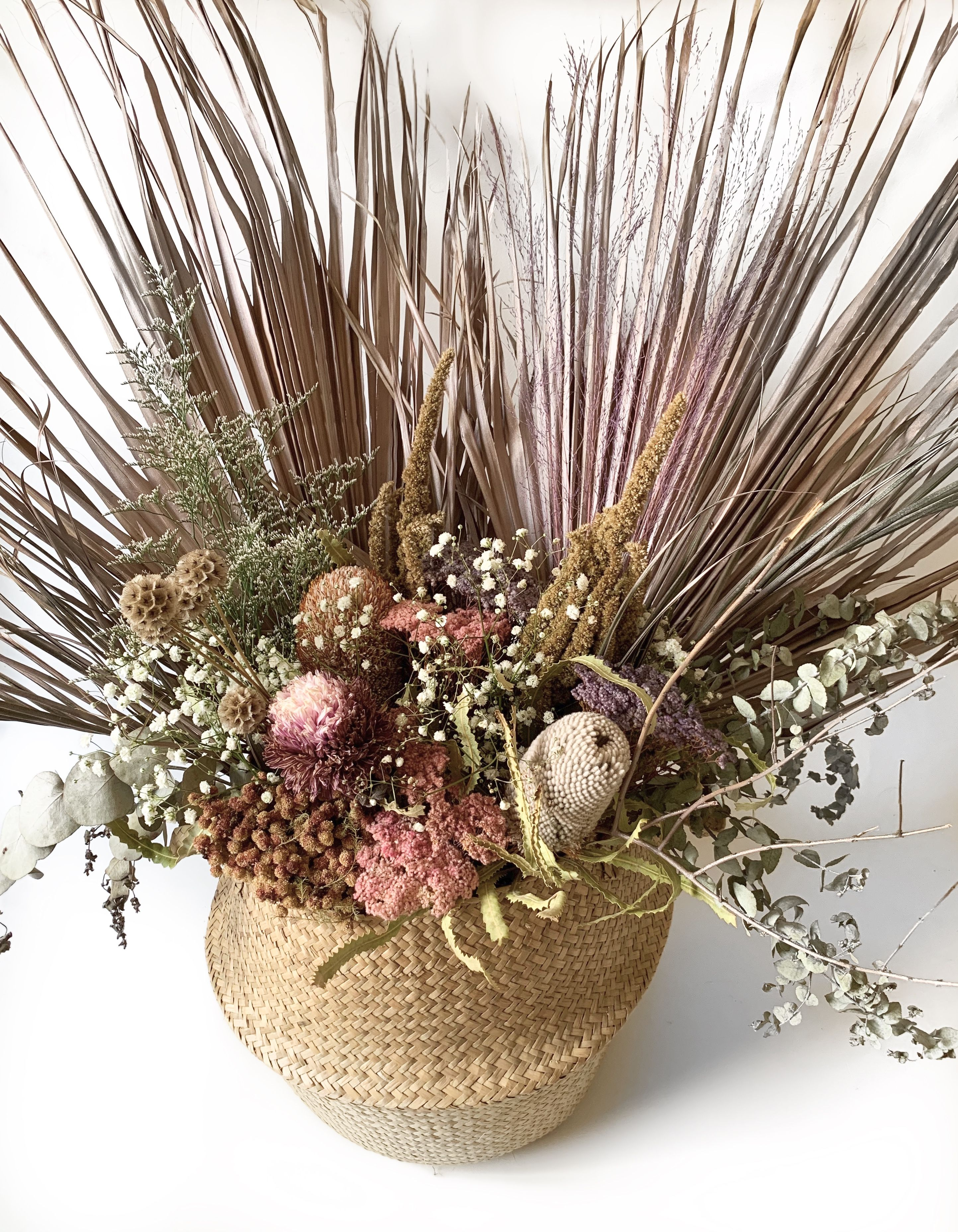 Large Basket Arrangement Using Dried Palm Leaves And Flowers