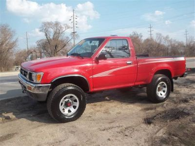 Red Pickup Truck And The Boy Who Drives It Used Toyota Toyota Pickup For Sale Toyota