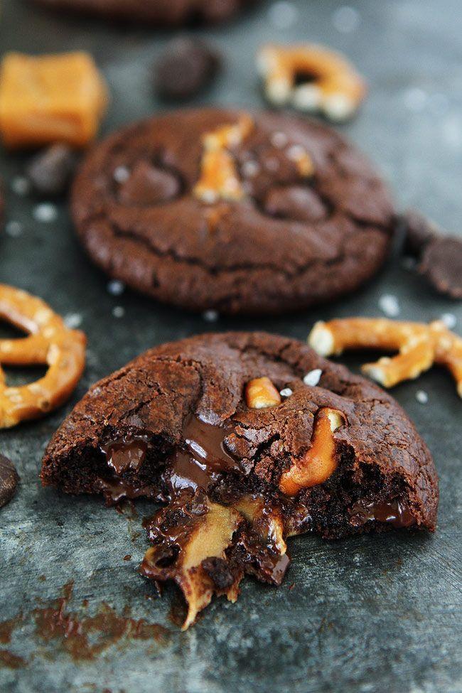 Chocolate Salted Caramel Pretzel Cookies Recipe on http://twopeasandtheirpod.com /twopeasandpod/ Chocolate cookies with a gooey caramel center, pretzel pieces, and a sprinkling of sea salt.