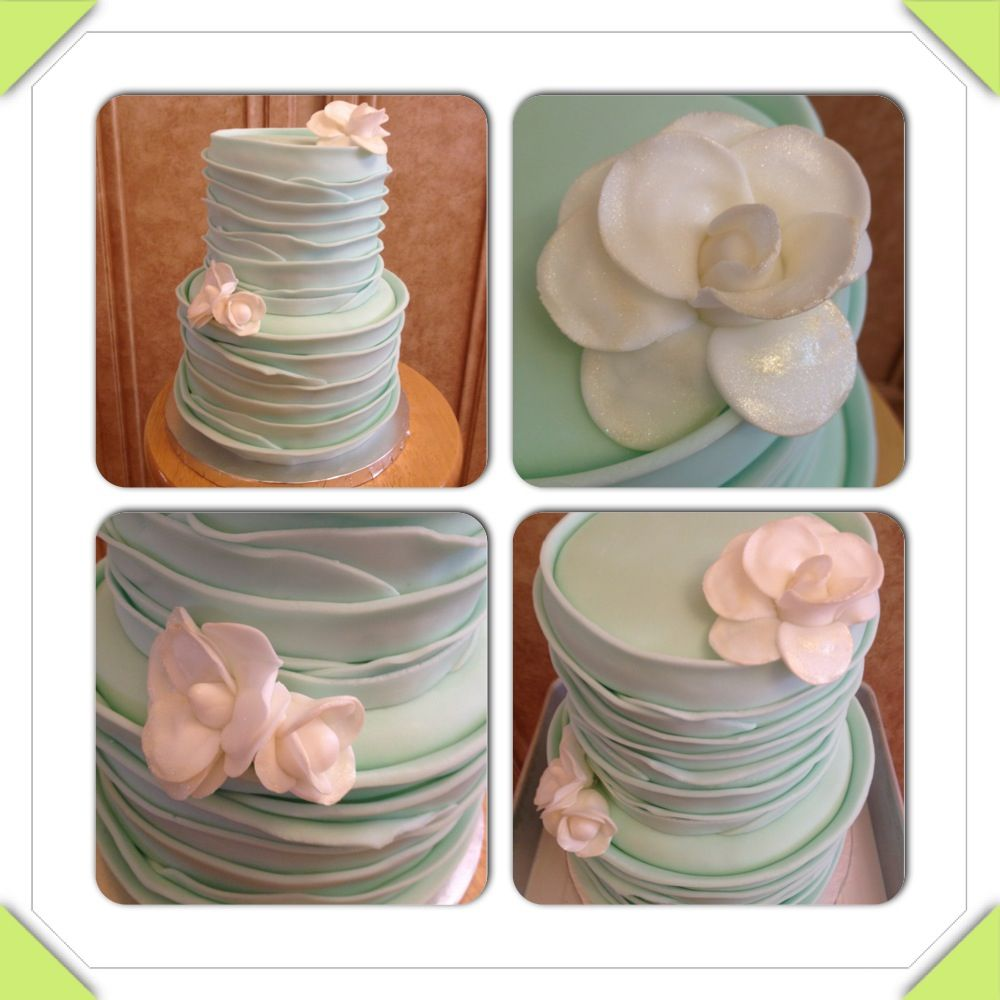 Mint ruffle cake with gold-dusted white flower accents. www.facebook.com/cakeitorleaveitcakesbymarianne