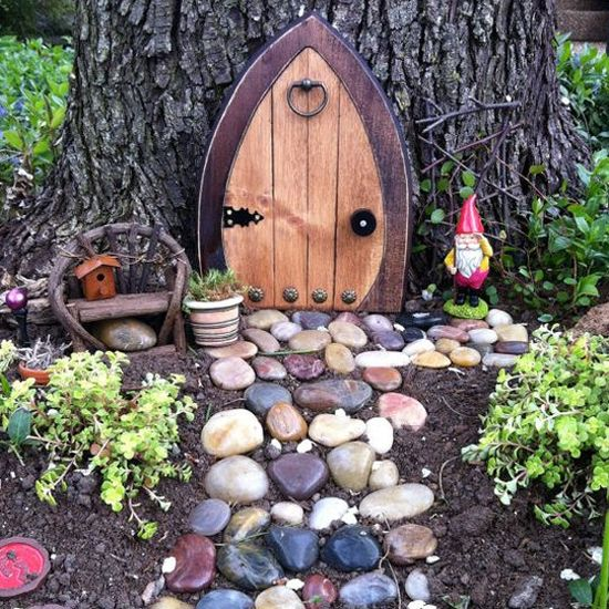 Fairy doors in the garden fairy doors tree trunks and elves for Elf fairy doors