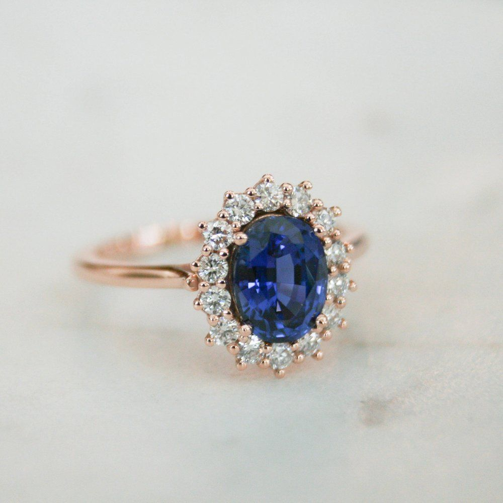 Details  Metal: 14K Gold  Center Stone: 6x8 Oval Blue Sapphire (Chatham)  Accent Diamonds Weight: 0.33