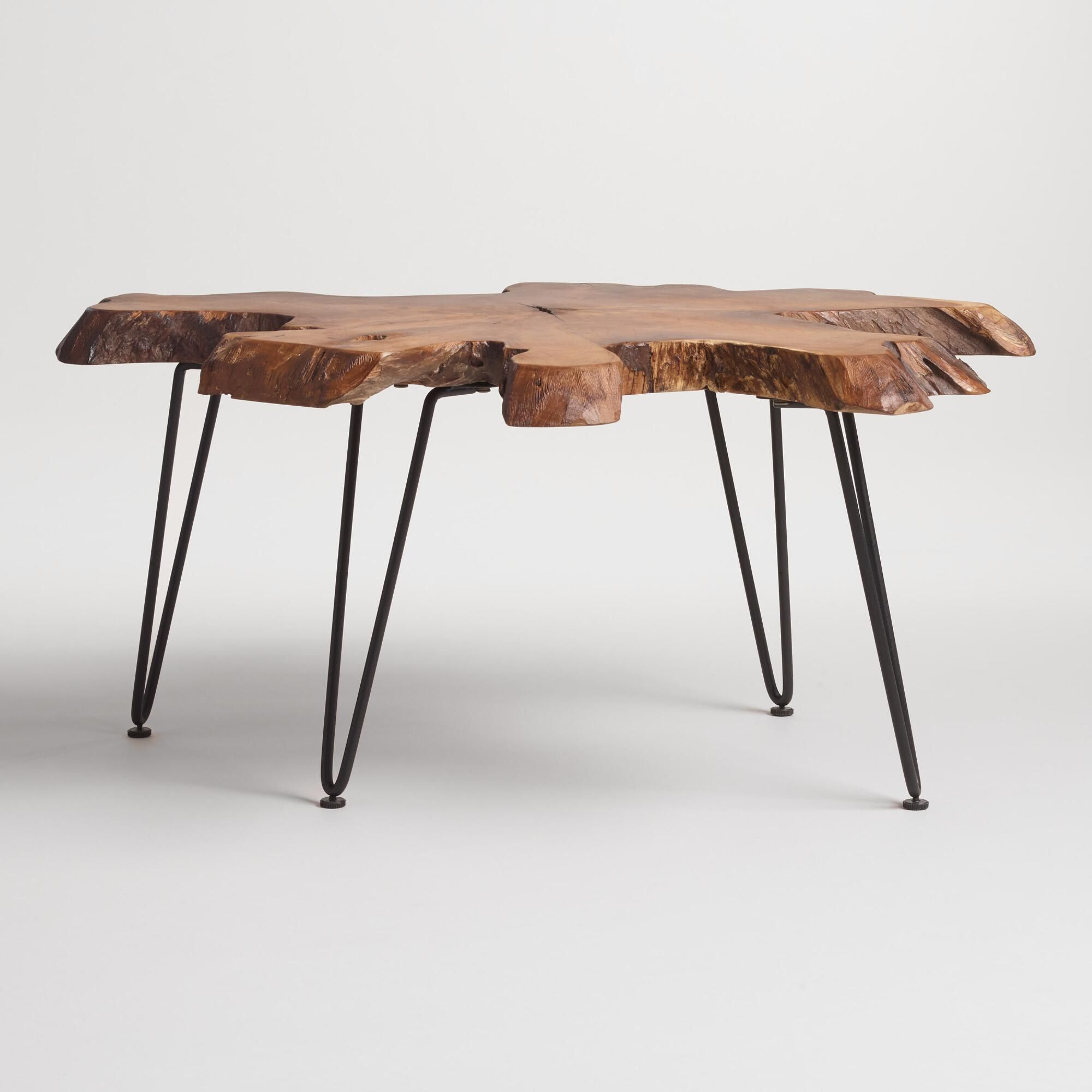 Our coffee table is crafted in Indonesia from a real slice of richly-grained teak root with inherent holes, knots and variations in size and shape. Featuring black mid-century style hairpin legs, this standout piece is truly one of a kind.
