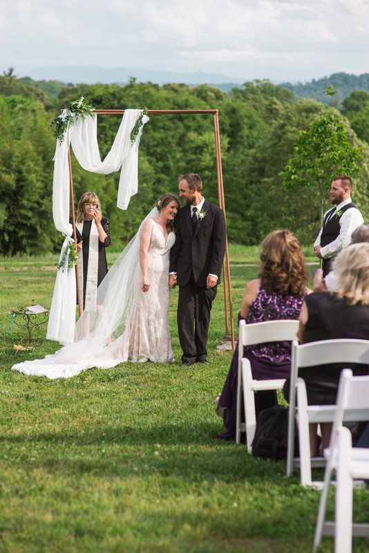 Ceremony in the field overlooking the mountains. It was a ...