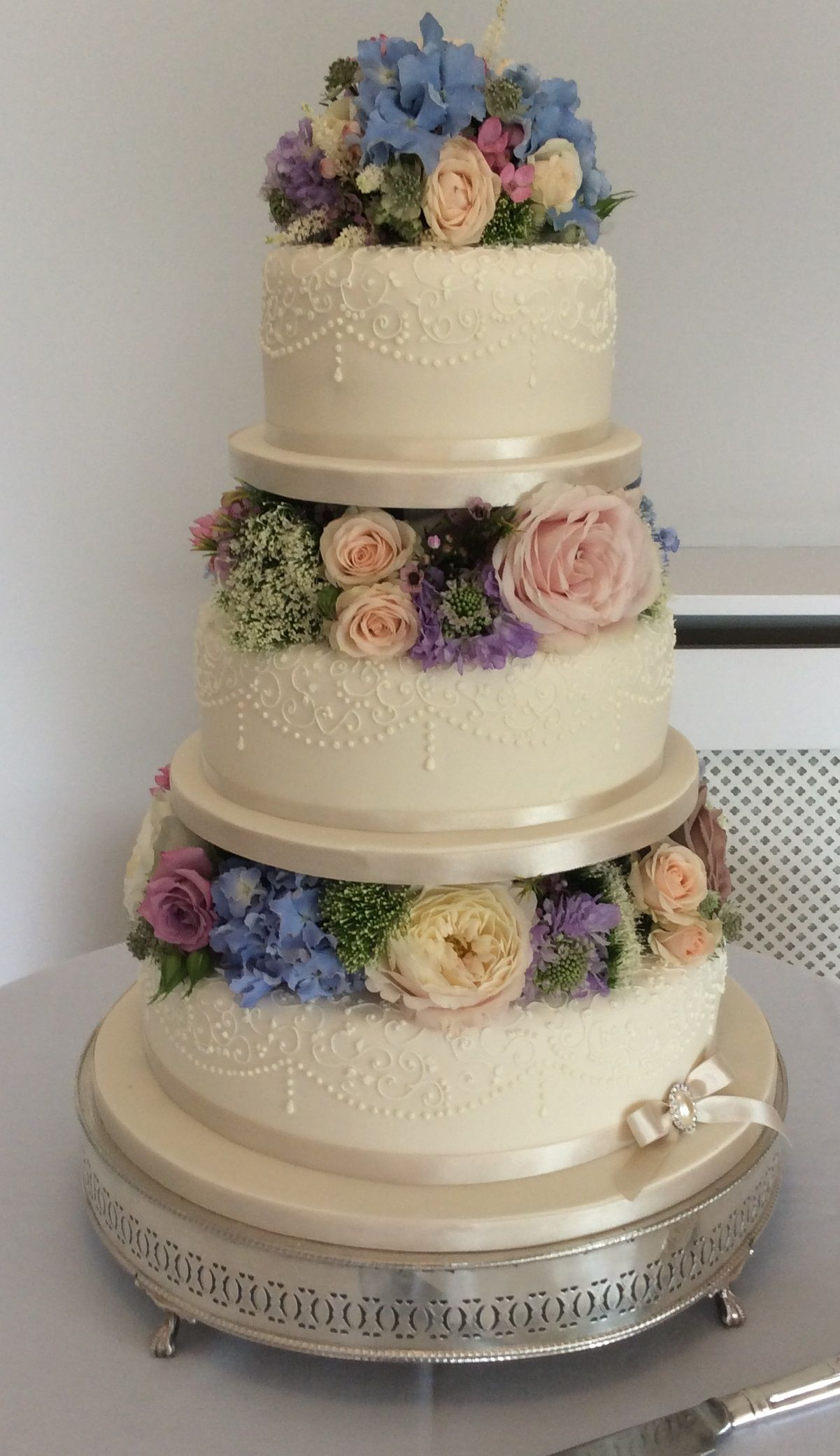Gabi a favourite design of ours softly finished tiers decorated