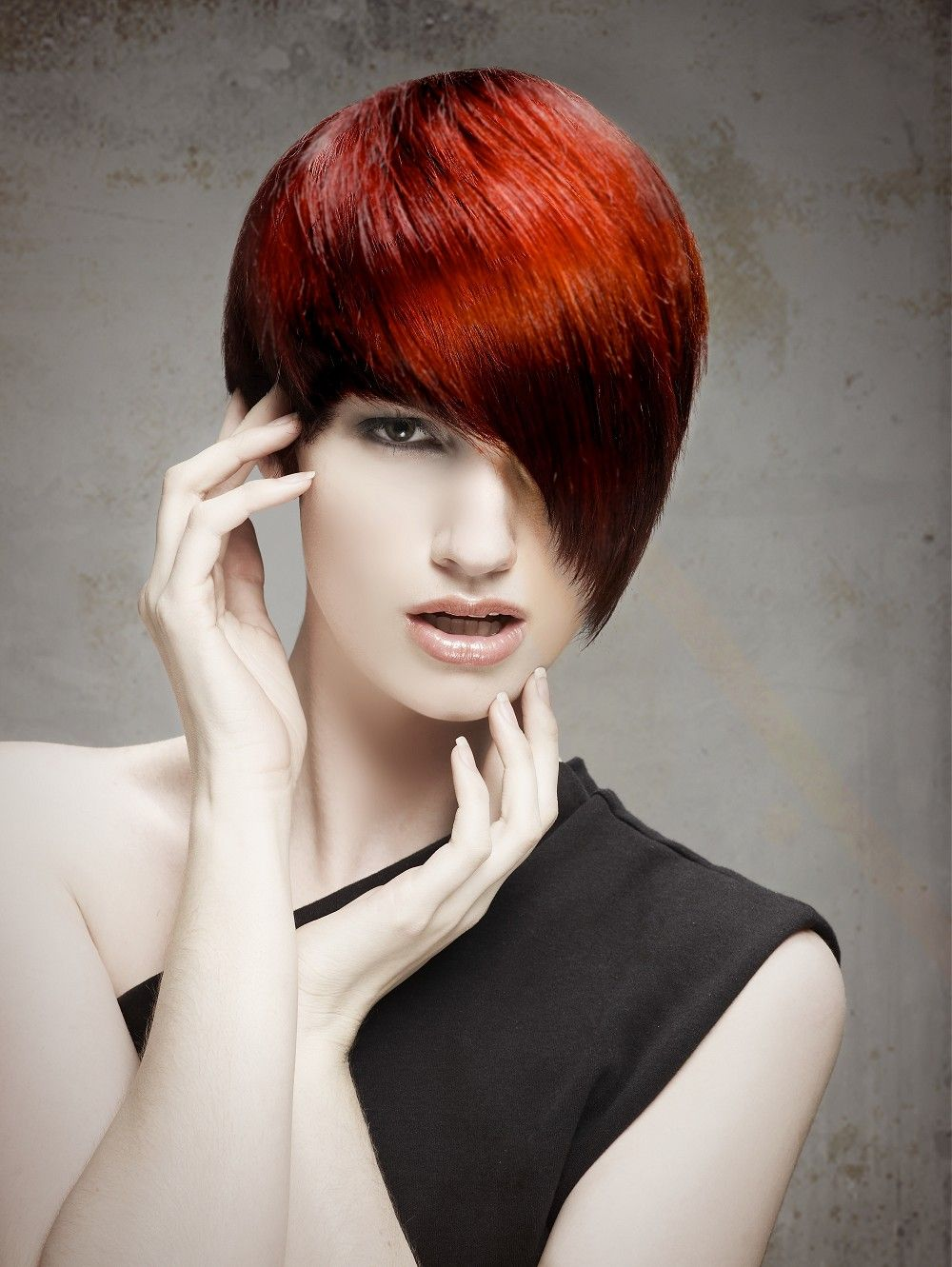 Short red straight hairstyle provided by sherri jessee cici hair