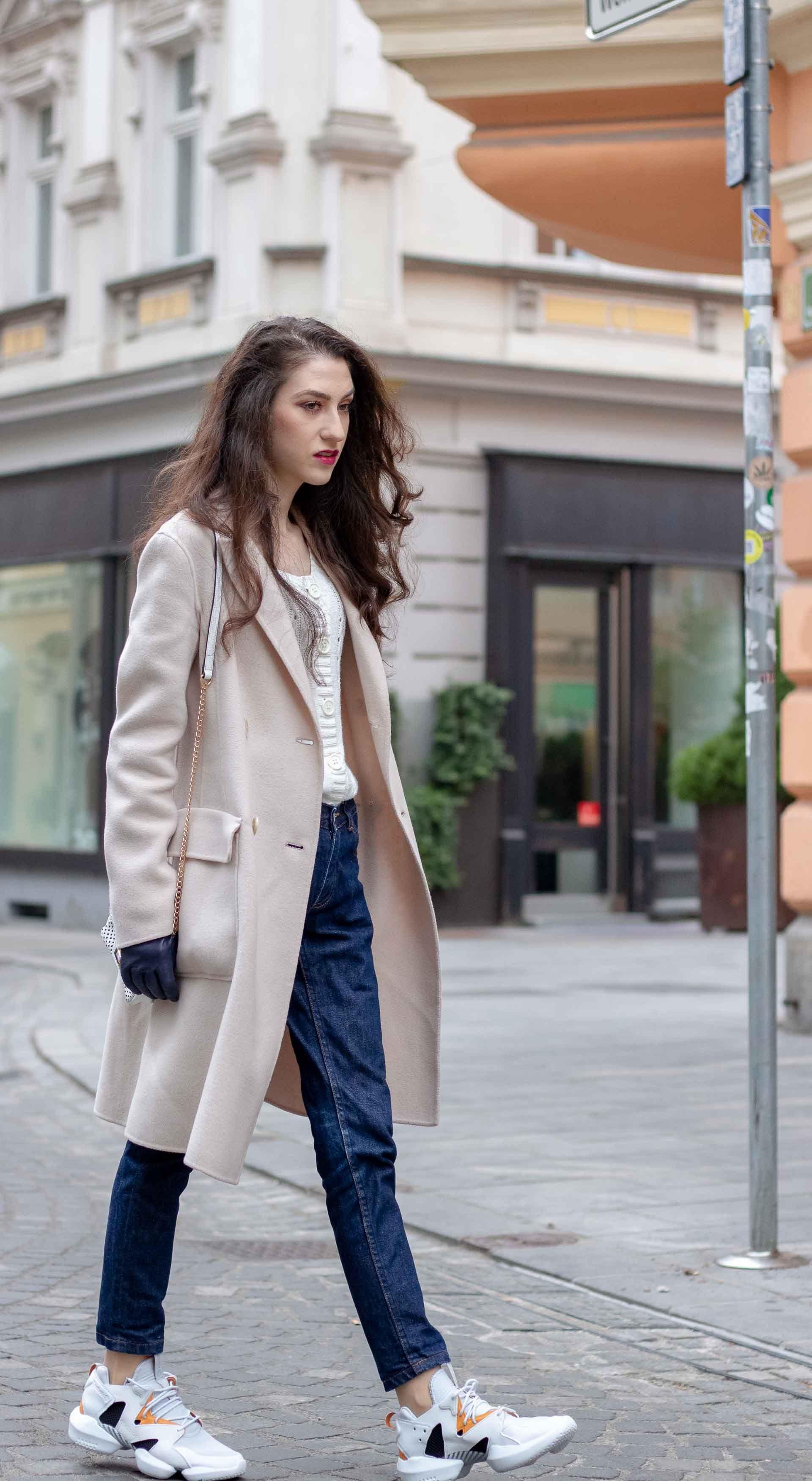 c015c484 Beautiful Slovenian Fashion Blogger Veronika Lipar of Brunette from Wall  dressed in white Mango cardigan tucked into A.P.C. dark blue denim jeans,  Weekend ...