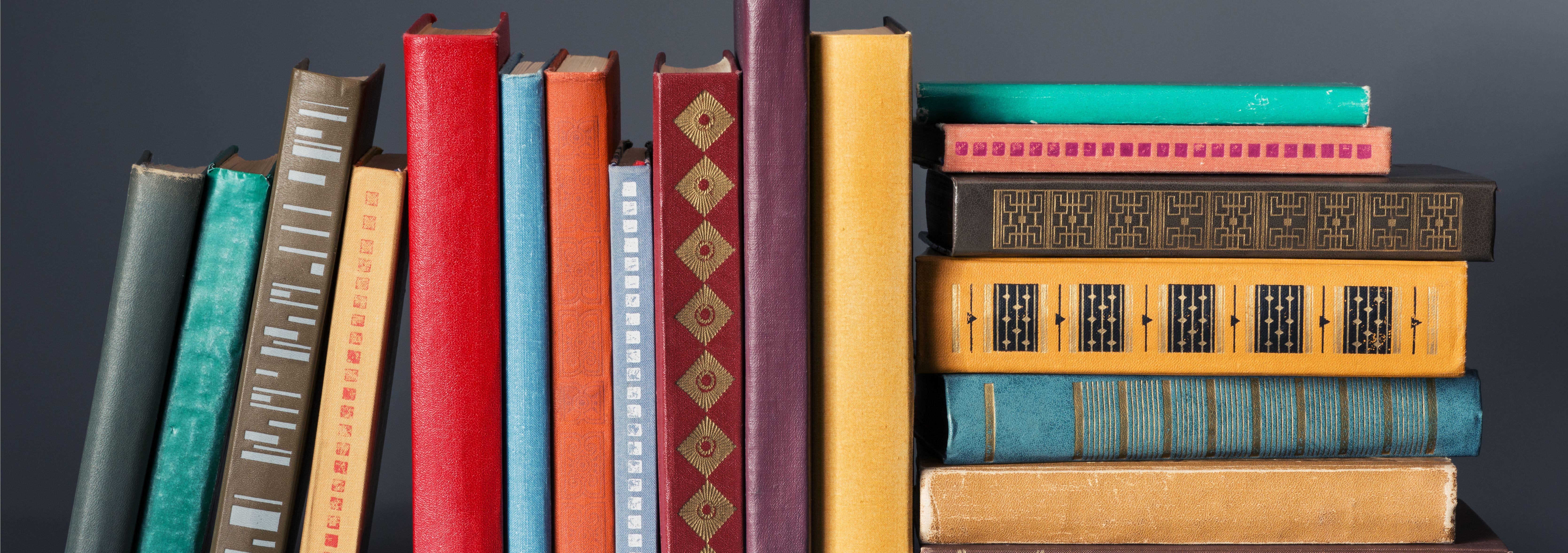 Books and textbooks on the bookshelf. 3d