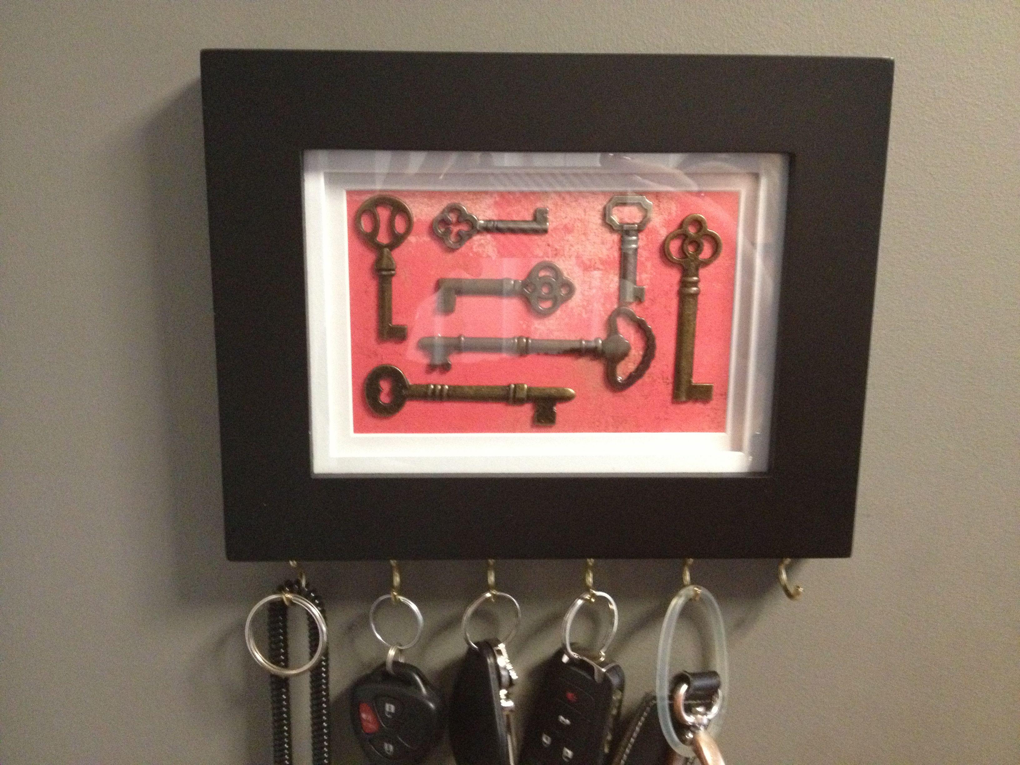 DIY key rack. Frame + hooks + scrapbook paper + decorative metal keys =  quick